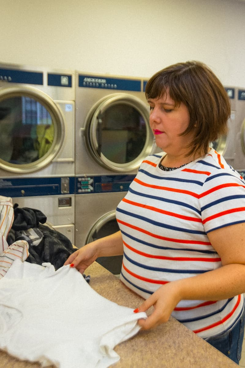 Like most neighborhood renters, Emily spends a lot of time at the laundromat.